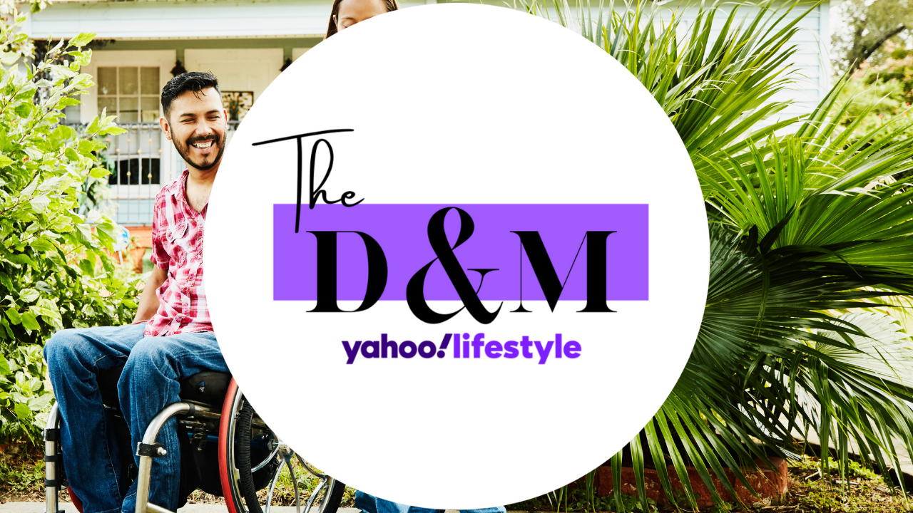 Man in wheelchair in front of house with DM logo