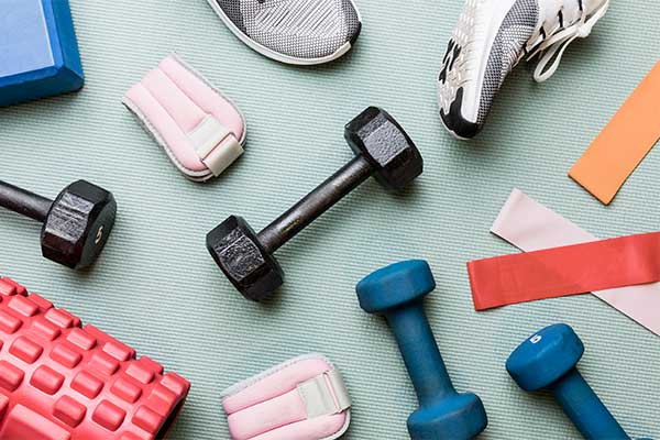 At Home. A picture of barbells and other fitness, exercise and wellbeing equipment. (Getty Images)