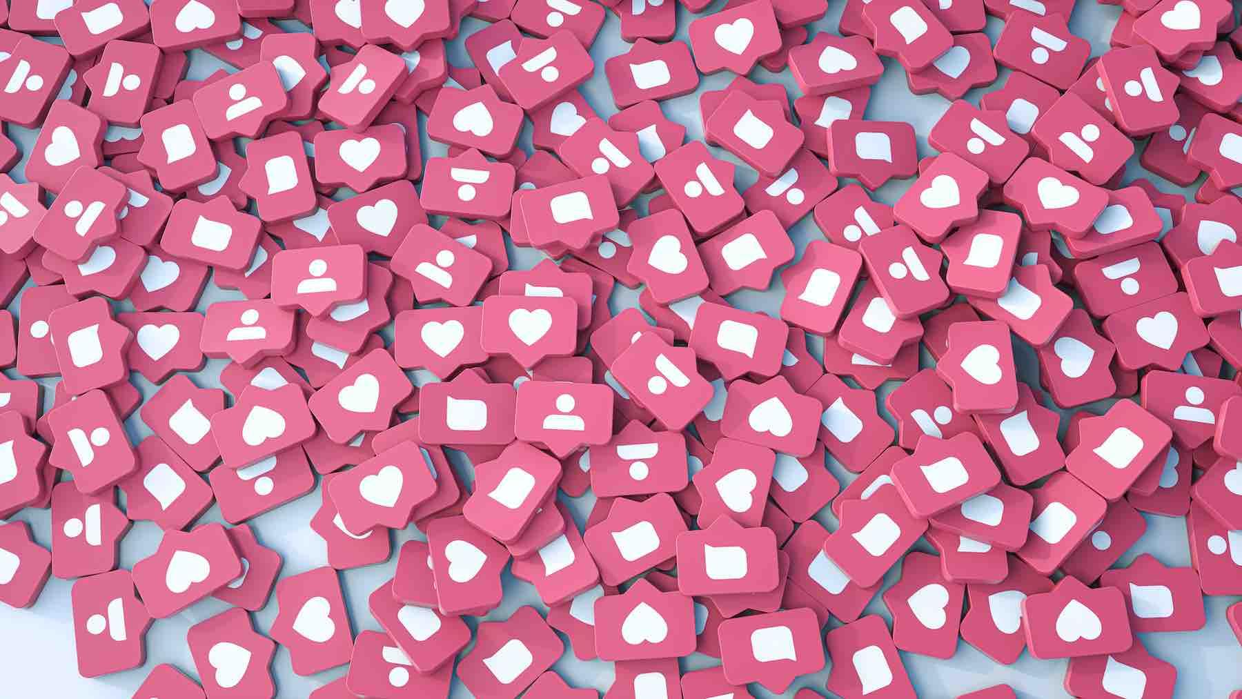 Montagem com centenas de ícones de notificação de like, como os das redes sociais.