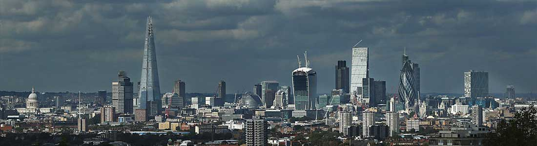 A view of buildings in the London skyline on a cloudy day